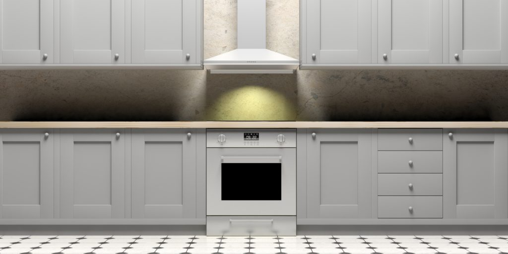 Kitchen cabinets and eletric oven on ceramic tiles floor, front view. 3d illustration